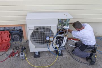 heat Pump. plumber at work installing a circulation heat pump