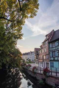 Sunrise in the old town of Colmar, Alsace, France on a sunny day. water canal and traditional half timbered houses.  Also known as  Petit Venice.