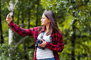 Young female photographer with dslr camera