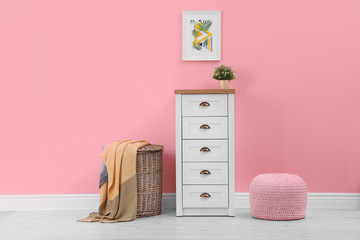Chest of drawers in stylish living room interior Wall mural