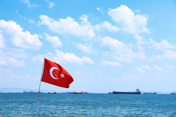 Turkish flag and seascape with ships on background