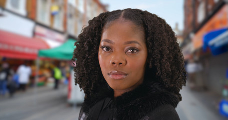 Portrait of attractive black woman at popular street market in London, England