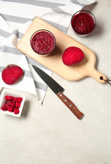 Flat lay composition with beet smoothies on light background. Space for text