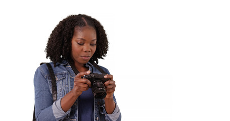 Cute African American woman looking around excitedly and taking photos in studio