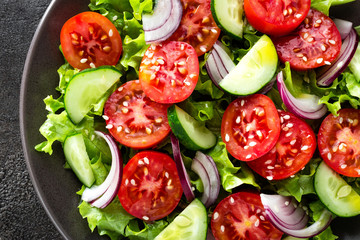 Salad. Fresh vegetable salad with tomato, cucumber, lettuce and red onion