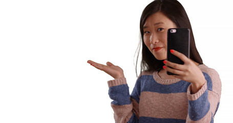 Close up of cute woman taking selfie using smartphone camera on copyspace