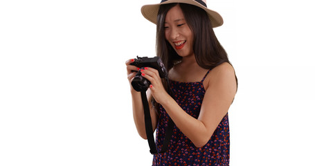 Closeup of Asian millennial photographer taking pictures for copy space