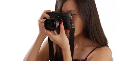 Close up of Asian millennial photographer taking photos for copy space