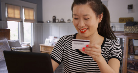 Portrait of young Asian woman paying online on the internet