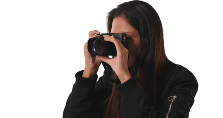 Closeup of hipster girl in bomber jacket taking photo with dslr camera in studio