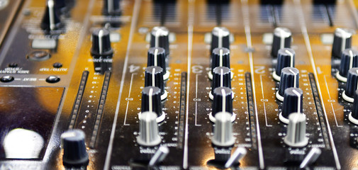 Close up professional audio DJ's turn table mixer console sound equipment.