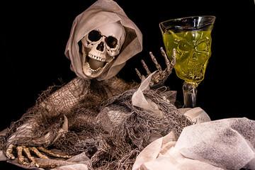 A skeleton embraces a  green potion.