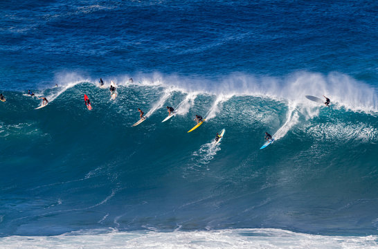 Surfers riding a wave in Hawaii
