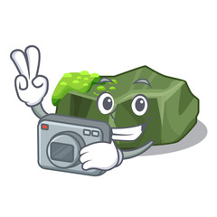 Photographer cartoon large stone covered with green moss