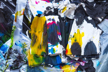 abstract background of colored paint from printer on paper. a topic for waste and garbage