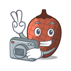 Photographer mascot cartoon of moriche palm fruits