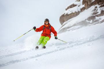 Skier freerides at offpiste slope
