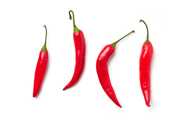 Tuinposter Hot chili peppers Red chili pepper on a white background. Red chili pepper of different shapes isolated on white background