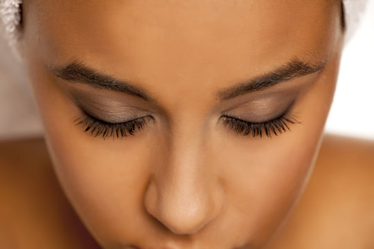 natural eyebrow and eyelashes with mascara of dark skinned female