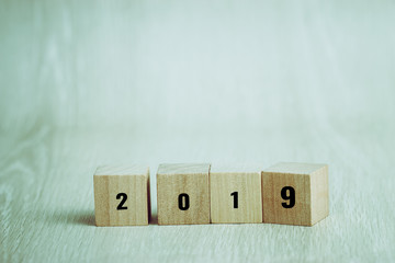 New year 2019 planing for business study calendar ideas : Wooden square tower blocks cube with numbers for schedule plan to goal success, Copy space for letter advertising or decoration