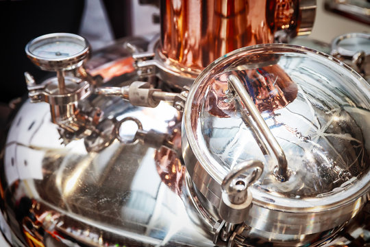 fragment of copper alembic for making alcohol
