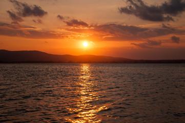 Beautiful evening sunset on the sea. Amazing sunset on black sea and beautiful cloudscape.