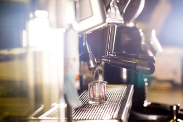 Barista make coffee espresso shot by streaming machine in coffee cafeteria bar. Brewing Process concept. coffee blending process. image for background, wallpaper,decoration and copy space.