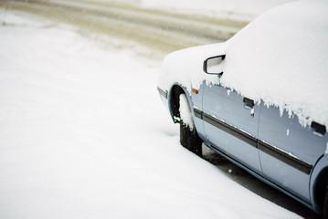 Snow on cars after snowfall. Winter urban scene.