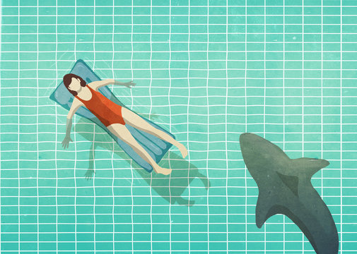 Shark swimming near woman in bathing suit on inflatable raft