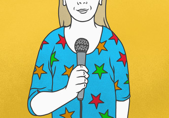 Woman wearing star-shaped shirt talking into microphone