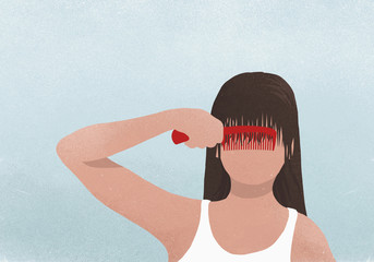 Brunette woman combing bangs