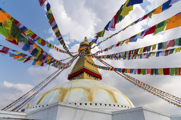 Boudhanath Stupa in Kathmandu and buddhist prayer flags