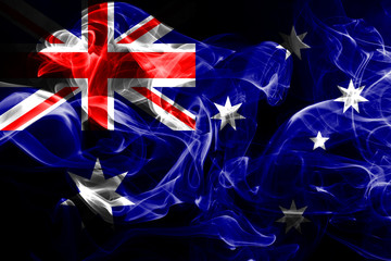 National flag of Australia made from colored smoke isolated on black background