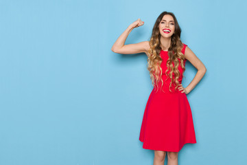 Smiling Elegant Woman Is Flexing Biceps