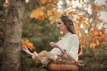 Elegant woman in autumn forest