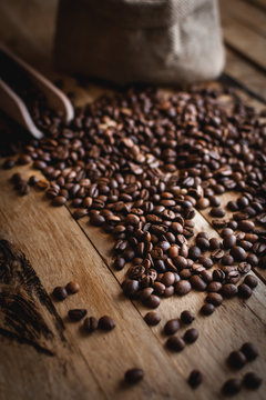 Close-up of coffee beans on wooden background