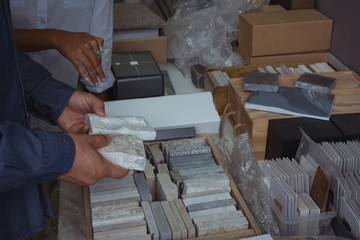 Architects checking marble sample
