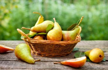 Fresh pears in wicker basket