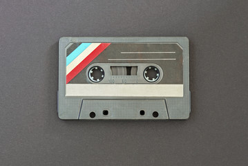 Retro audio tape on black paper background