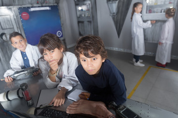 children solve tasks in the bunker quest room