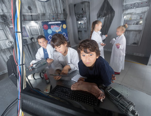 schoolkids solve task in the bunker quest room