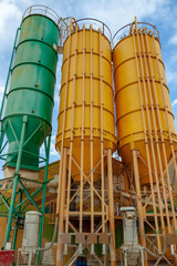 Three metal towers on chemical plant