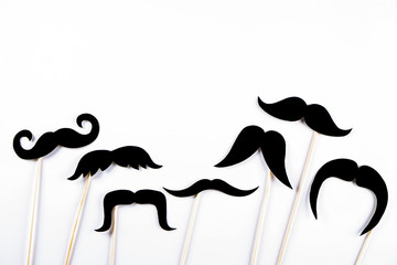 Movember concept. Annual event involving growing of moustache & beard during month in November to raise awareness of men's health issues and prostate cancer. Background, close up, copy space, flat lay