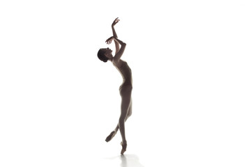 Young graceful female ballet dancer or classic ballerina dancing isolated on white studio. Caucasian model on pointe shoes