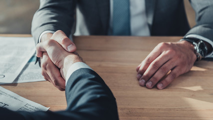 cropped shot of business partners shaking hands