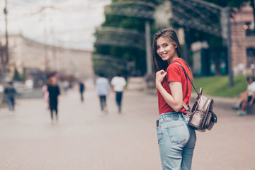 Straight-haired young beautiful smiling girl wearing casual red