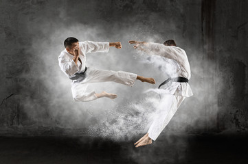 Two male karate fighting