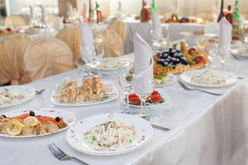 Restaurant table with snacks food at event.