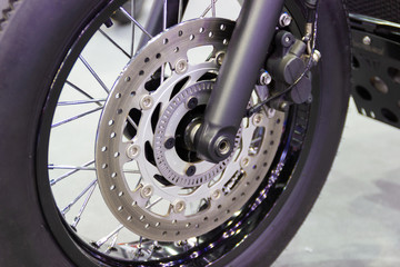 close up - wheel spokes and brake disc of a motorcycle