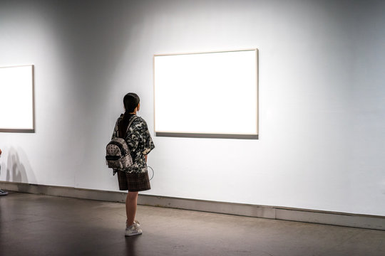 asia woman standing in front of blank board
